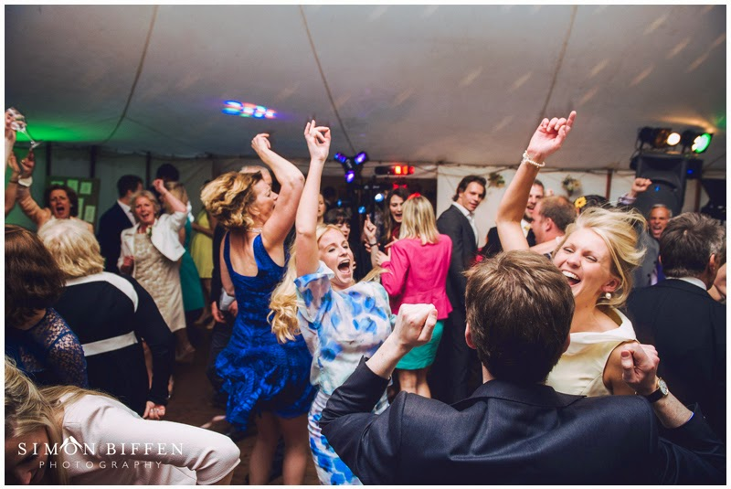 Party time on the dance floor at farm wedding reception Somerset