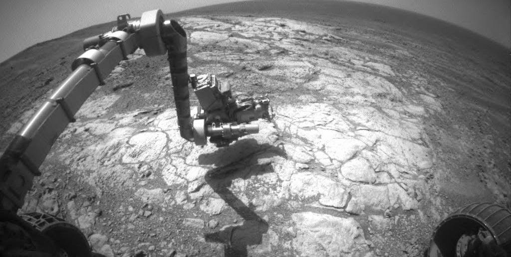 "NASA's Mars Exploration Rover Opportunity has extended its robotic arm for studying a light-toned rock target called ""Athens"" in this March 25, 2015, image from the rover's front hazard avoidance camera. Image Credit: NASA/JPL-Caltech"