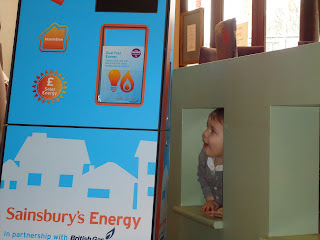 Baby Boy playing with the Sainsburys In store Mobile Energy Saving Stand