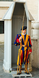 A soldier from the Swiss Guard on duty in the Vatican