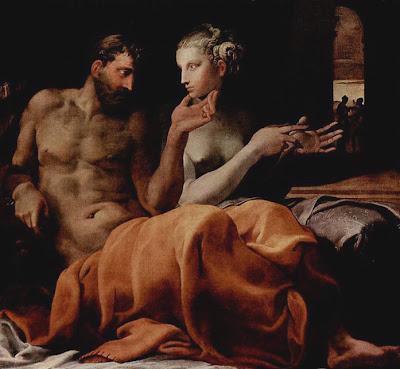 L'homme caresse le menton de la femme de sa main gauche