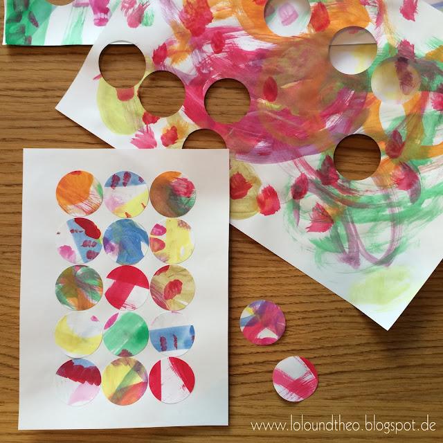 Blatt Papier, bemalt mit Wasserfarben, mit runden Löchern