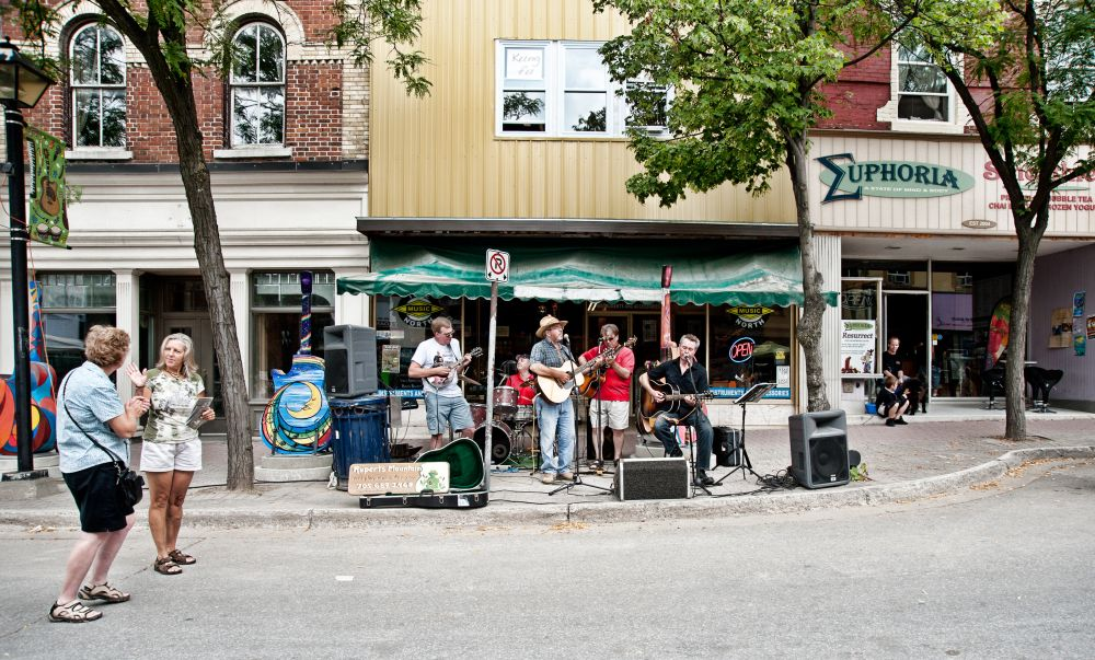 Visitors and local residents fill the downtown streets during one of Orillia's downtown sidewalk sales.