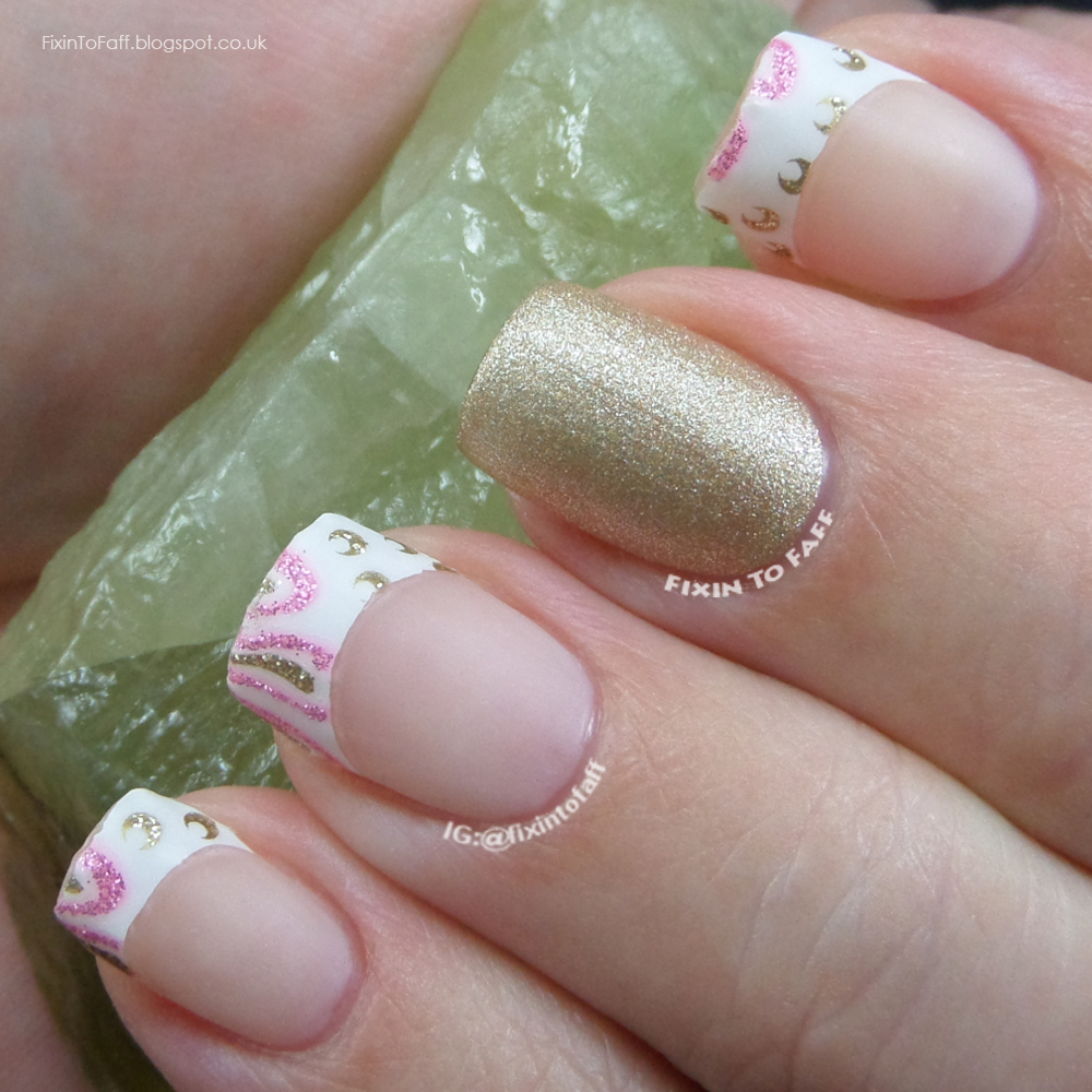Matte French tip look in pink white and gold with gold glitter accent.