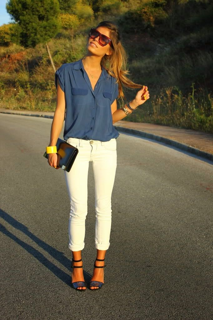 Blue blouse tucked In white skinny jeans with matching blue strappy heels