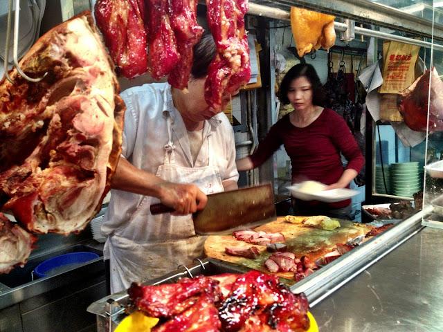 Chef chops BBQ pork in restaurant