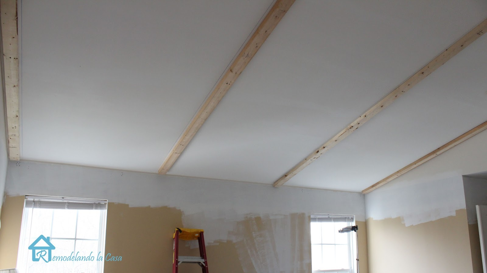 Installing faux wooden beams first part remodelando la for Adding wood beams to ceiling