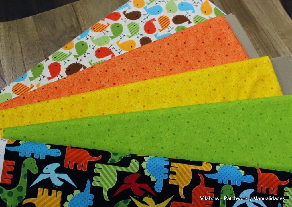 Telas muy coloridas para combinar con diseños de dinosaurios o pájaros