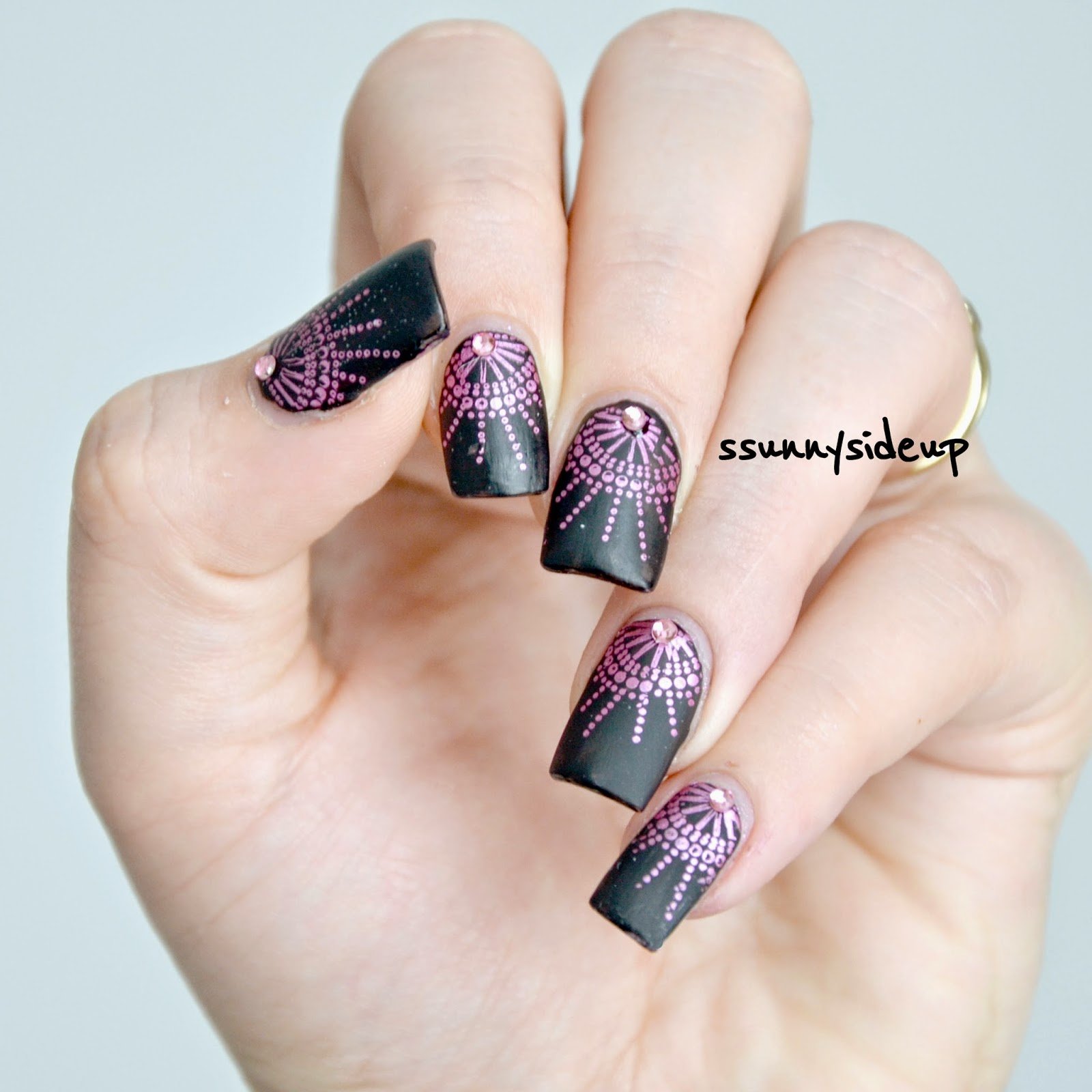 ssunnysideup: Black matte nails with chrome stamping