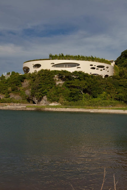 Photo of round home as seen from the lake