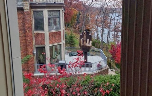 In WTF News: Sour Grapes? Ex-Husband Buys a House Next Door to His Ex-Wife and Props a HUGE Statue of a Middle Finger Pointed Toward Her House!