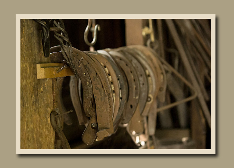 A close-up photograph of horseshoes in the blacksmith's shop at Black Creek Pioneer Village.  Holly Cawfield Photography