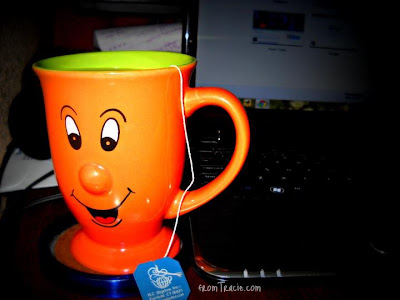 orange mug with smiley face