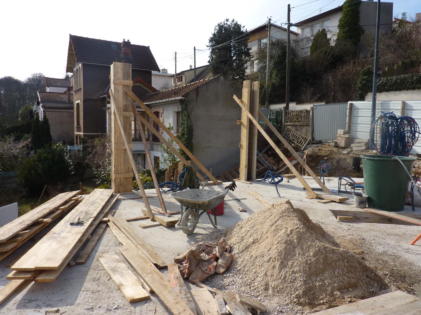 Construction d 39 une maison bois plessis robinson for Dalle beton pour maison