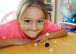 "Using Janice VanCleave's ""84. Bonded"" experiment as a guide, Tessa constructed a model of the physical structure of a methane molecule with toothpicks and gumdrops."