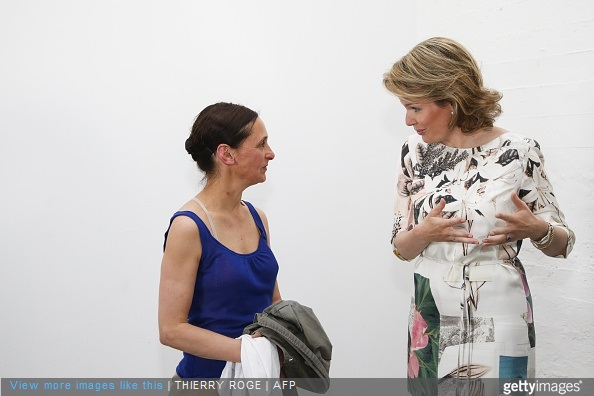 Belgian dancer and choreographer Anne Teresa De Keersmaeker and Belgium's Queen Mathilde talk during a visit to the exhibition Work/Travail/Arbeid by Anne Teresa De Keersmaeker in collaboration with Rosas at the contemporary art center Wiels in Brussels