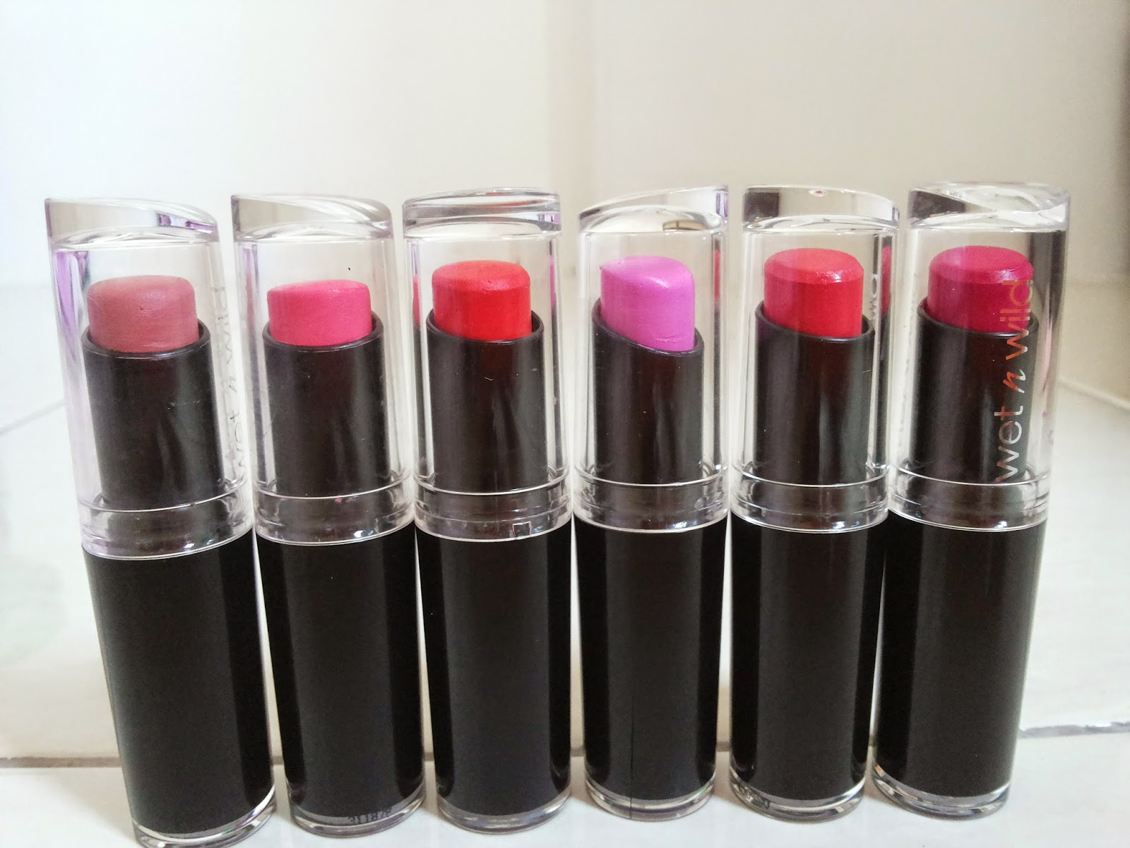 Wet n wild megalast lipstick Pinkerbell Dollhouse pink Just peachy Purty persimmon Coral ine Cherry picking