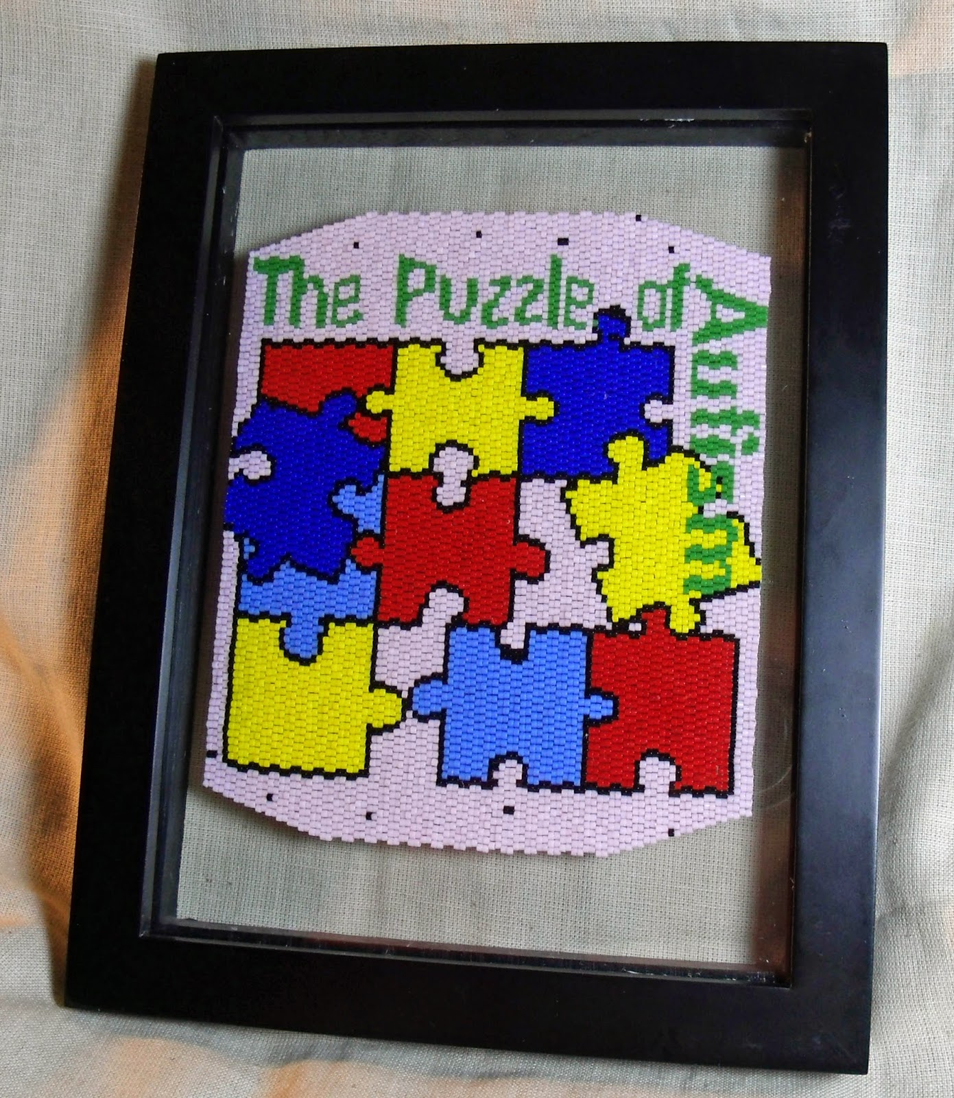 http://www.artfire.com/ext/shop/product_view/KraftyMax/4096681/The_Puzzle_of_Autism_Framed_Fully_Beadwoven_Artwork/Mixed_Media/Wall_Hangings