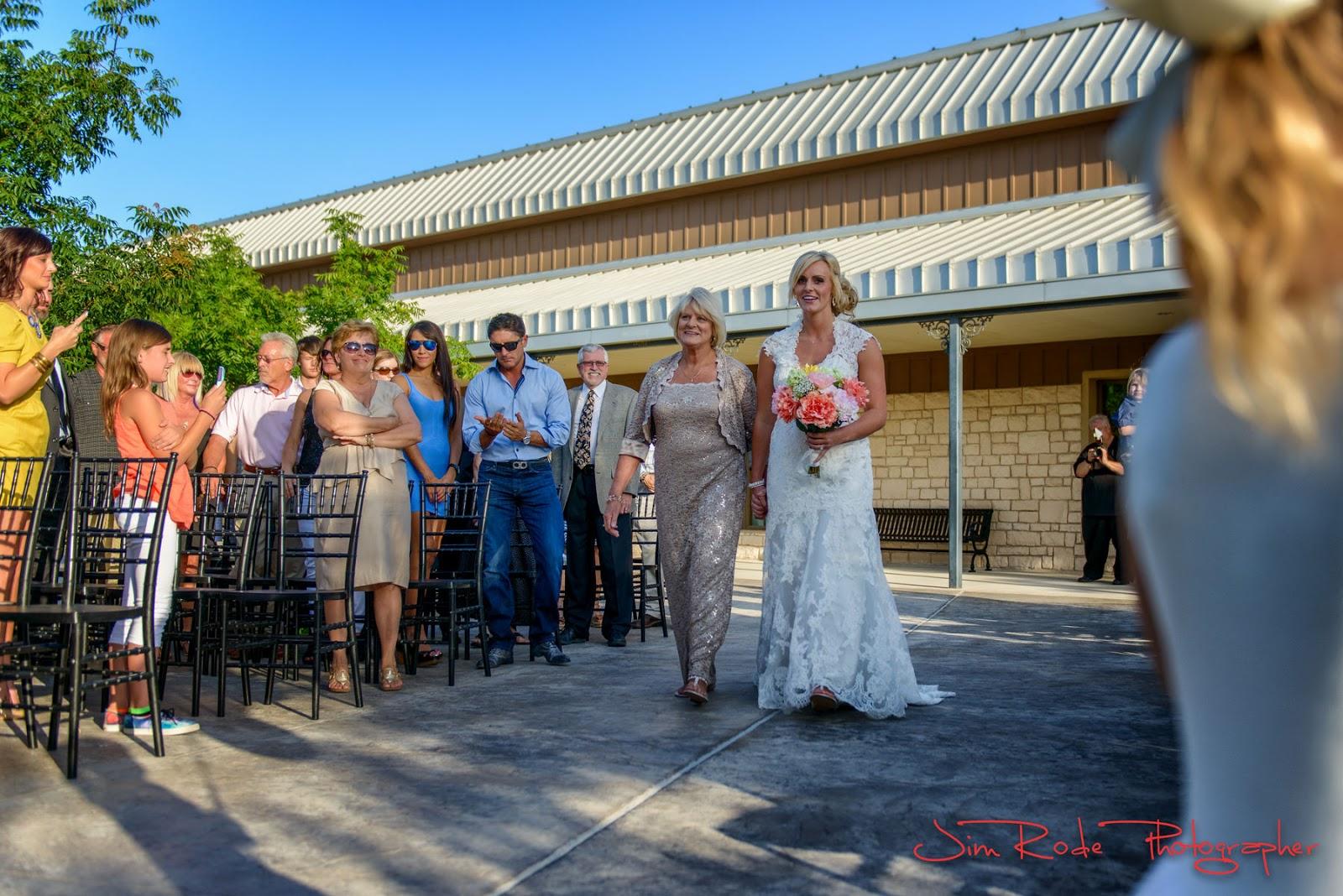 Mom walks the bride down the aisle at her Grand Prairie wedding.