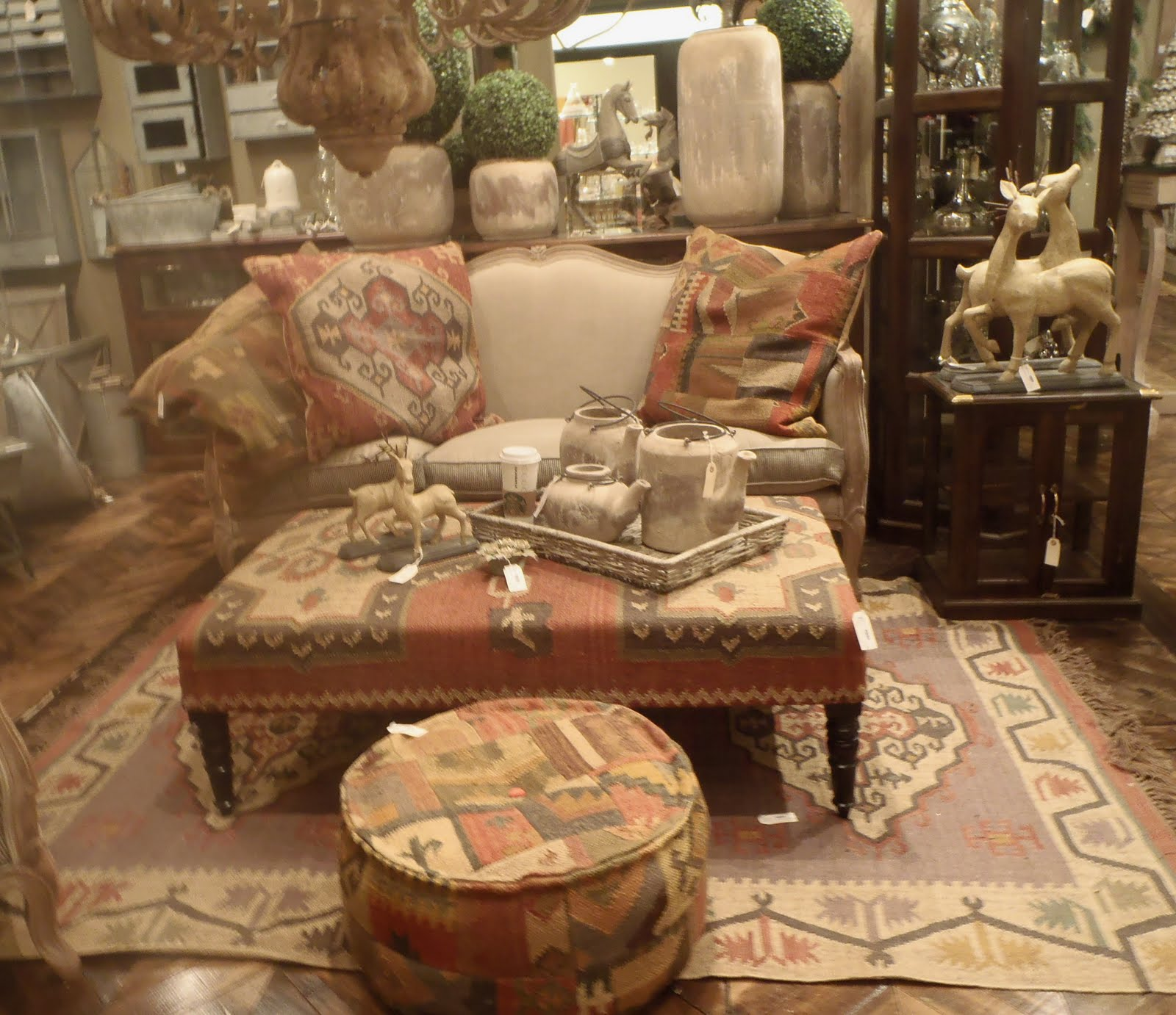 Gentil Teaming Of The Moroccan Kilim With The Linen Sofa. The Warm Earth Tones In  The Different Patterns On The Pillows Ottomans And Rug Do Not Fight With  Each ...