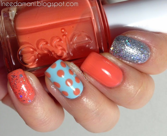 Polka dots, peach, blue, and silver glitter nails