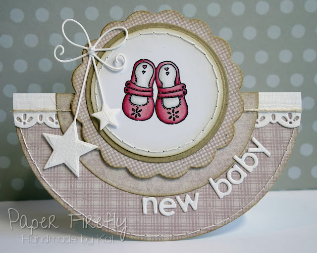 Pink rocker card with baby shoes