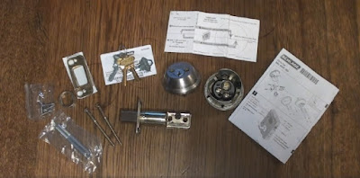 Unboxed Schlage double cylinder lock set contents displayed