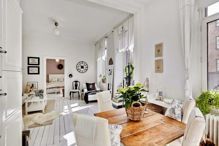 białe wnętrze, styl skandynawski, wiklinowy koszyk, ratanowy koszyk, kuchnia, salon, stół