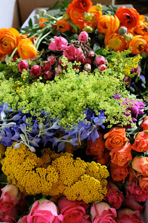 explosion of different flowers at a flower stand with a symphony of colors