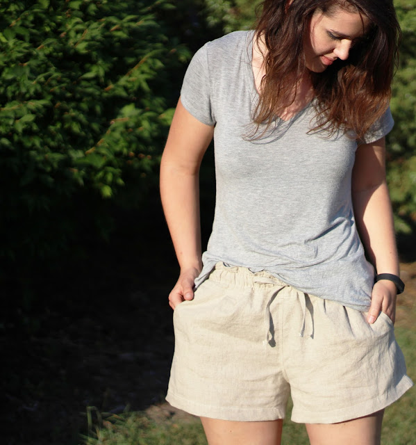 image of me with hands in pockets of casual linen shorts that i made on my sewing machine