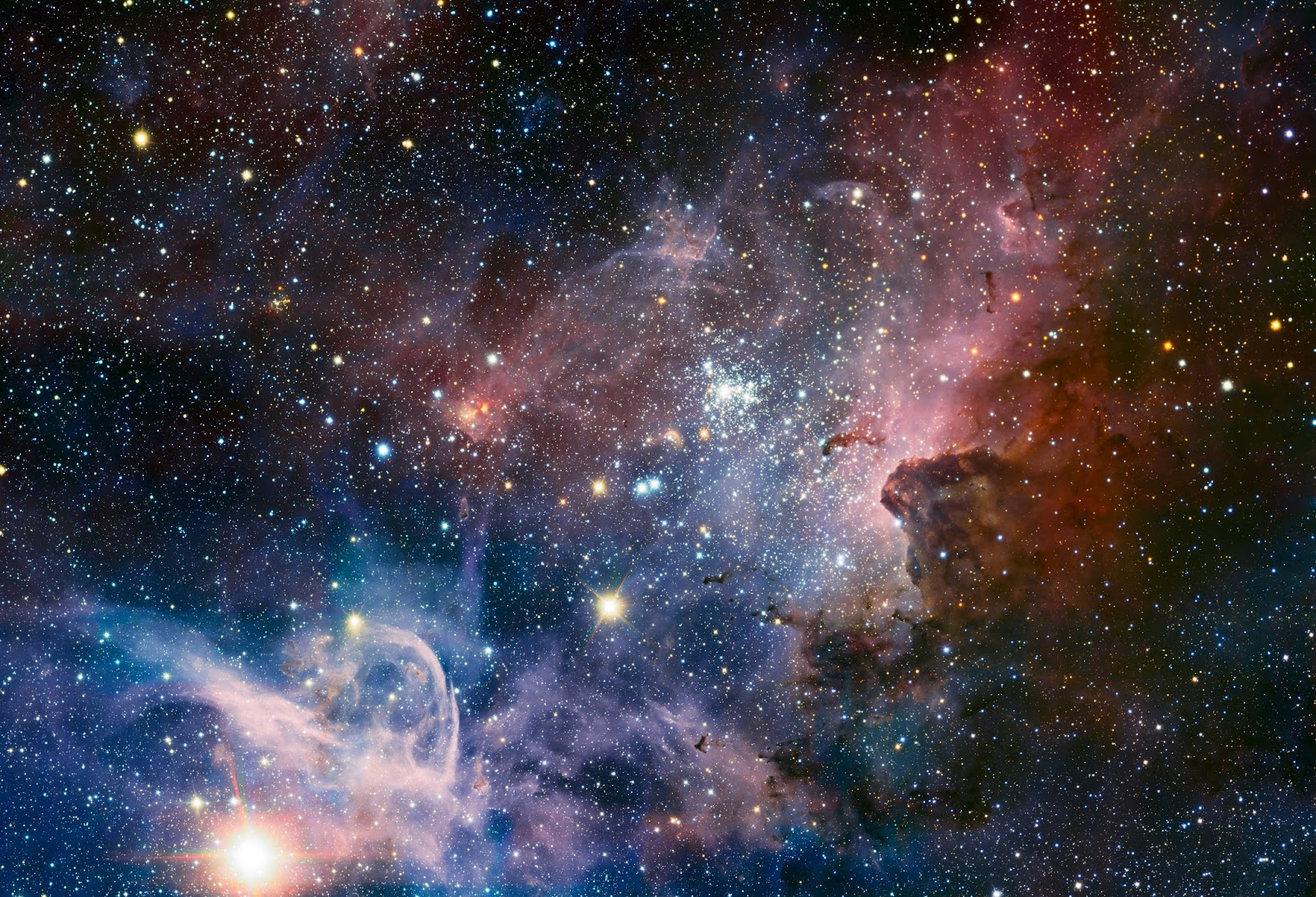 This broad image of the Carina Nebula, a region of massive star formation in the southern skies, was taken in infrared light using the HAWK-I camera on ESO's Very Large Telescope. Many previously hidden features, scattered across a spectacular celestial landscape of gas, dust and young stars, have emerged.  Image Credit:ESO/T. Preibisch Explanation from: http://www.eso.org/public/images/eso1208a/
