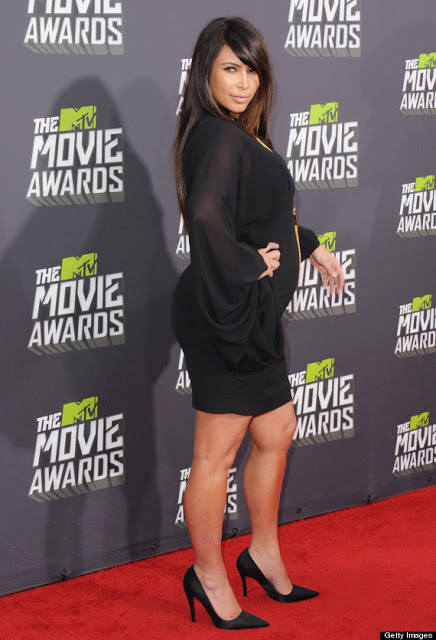 Black dress which stopped right above the knee accentuating her