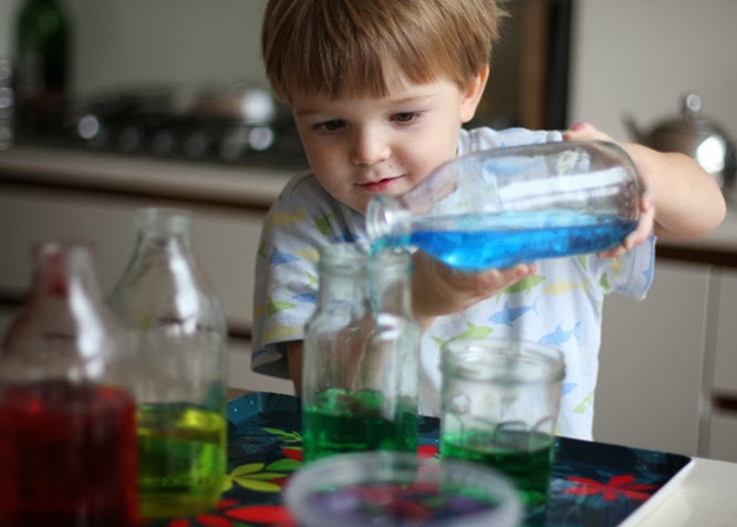 Henry pouring water coloured with food colouring