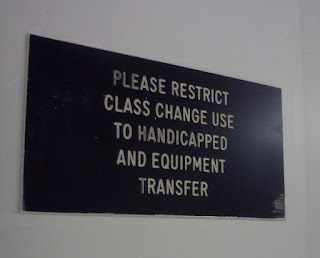 """A sign on an elevator on my campus. It reads """"Please restrict class change use to handicapped and equipment transfer"""""""