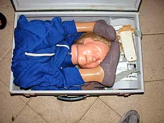 Resusci-Annie shoved into a suitcase