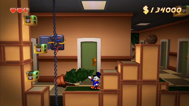 Screenshot of Scrooge McDuck and treasure chests in DuckTales Remastered
