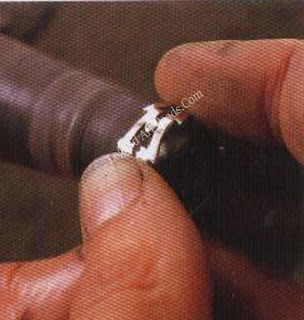 Polish the Inside of a Ring on a felt cone,which should be screwed to the shaft of the polishing motor.Hold the ring with both hands and press the sides against the cone while you rotate the ring.