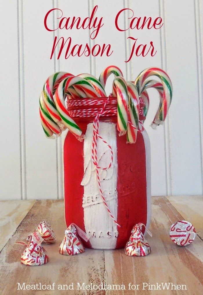 red and white mason jar with candy canes