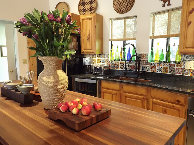 knotty pine kitchen,walnut countertops, mexican tile backsplash