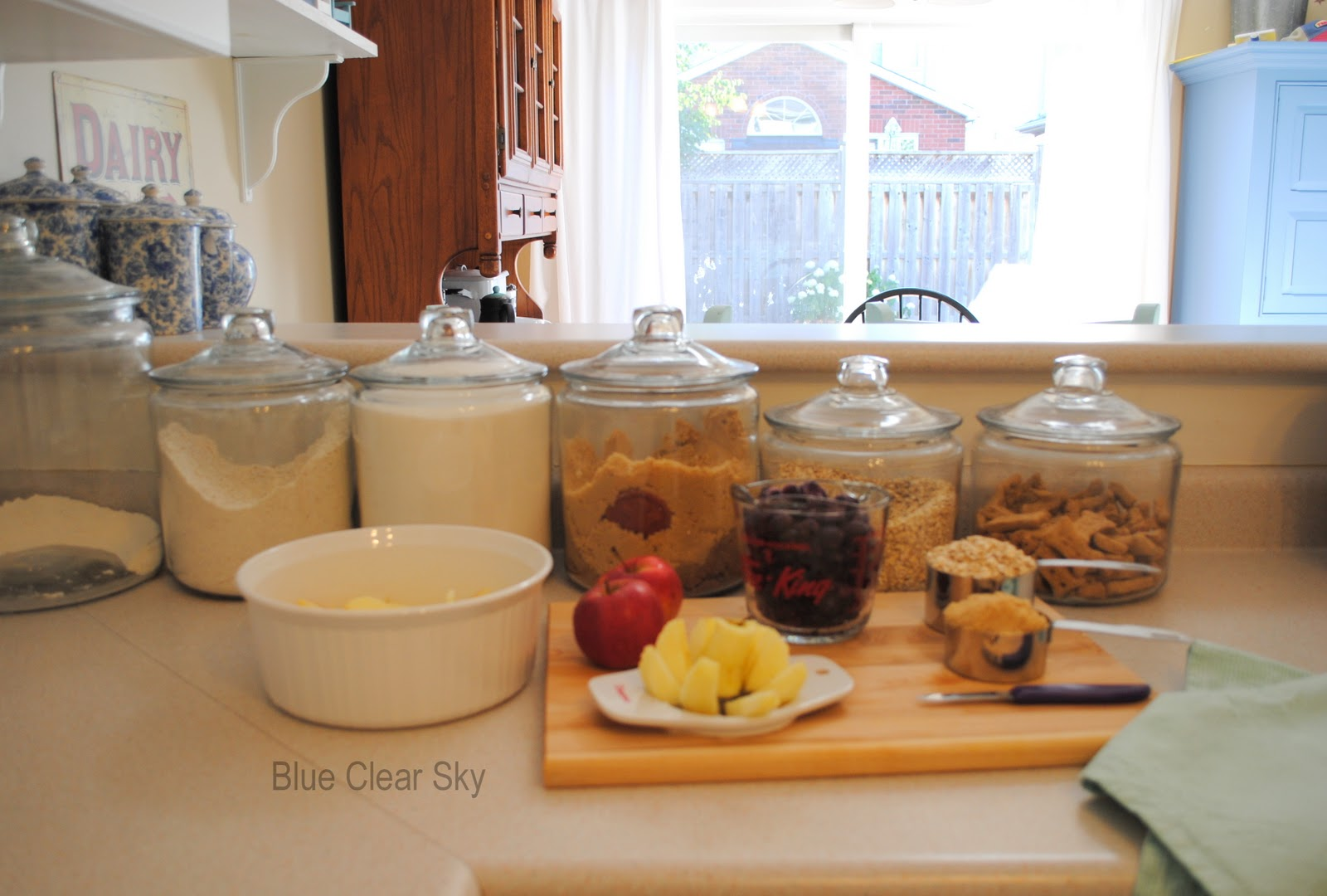 rustic maple our kitchen glass canisters keep my baking supplies and remington s treats close at hand