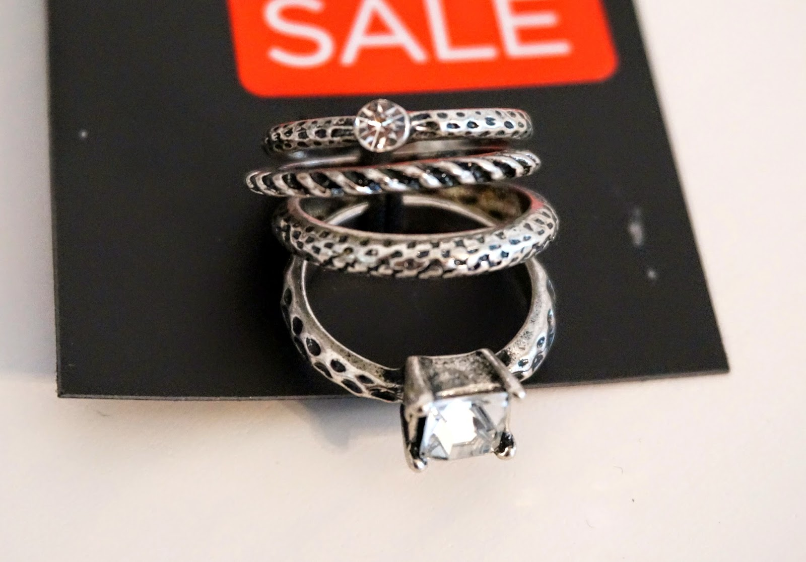 silver rings with snake pattern