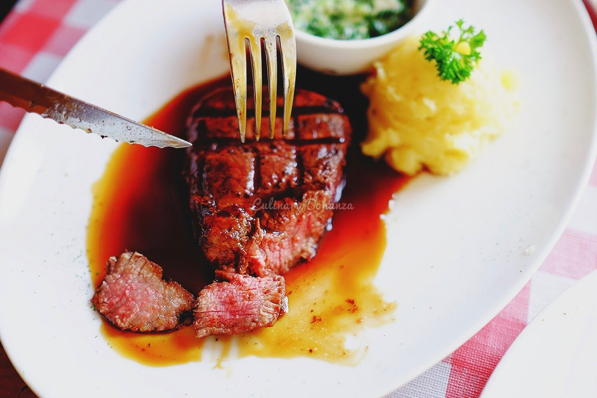 Tenderloin Steak served with BBQ Sauce and creamed spinach