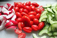 Radishes, tomatoes, and cucumbers