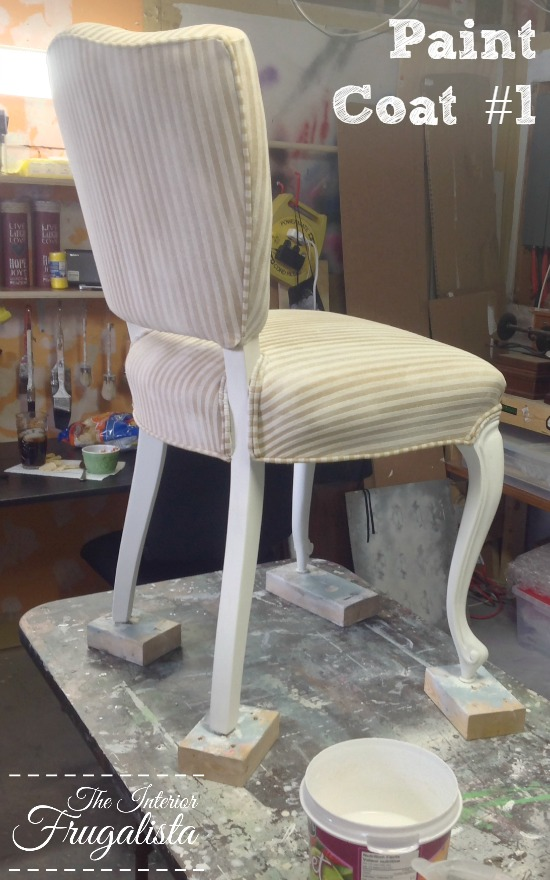 Chalk painting upholstery on a French Provincial chair after First Coat
