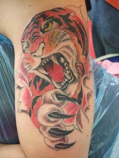 Skin Rip Tiger Tattoo Design