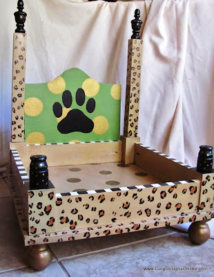 animal leopard print dog bed with paw print and dots