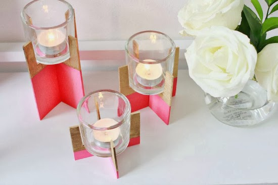 http://www.abeautifulmess.com/2014/01/paint-dipped-wood-candle-holder.html