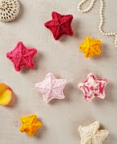 http://www.letsknit.co.uk/free-knitting-patterns/scattering-of-stars