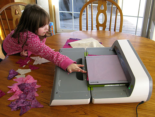 Kids helping with the AccuQuilt GO! BIG cutter
