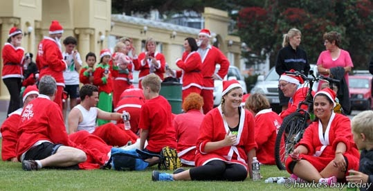 The Great KidsCan Santa Run, along the Rotary Pathway, a 2-3km fun run/walk along Marine Parade, start/finish at the Sound Shell, Napier, where most participants wore a santa suit. photograph